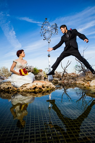 Groom leaping to bride